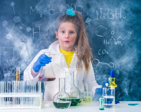 Photo for Excited schoolgirl in fume after chemical experiment in scool lab - Royalty Free Image
