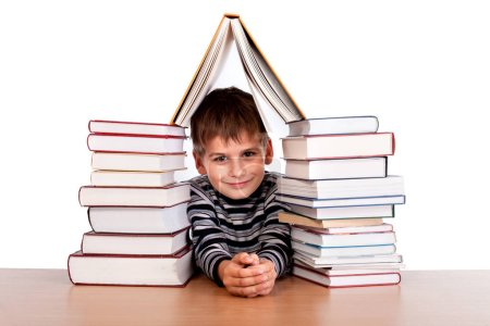 Schoolboy and heap of books