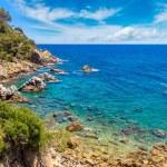 Rocks on coast of Lloret de Mar in beautiful summe...