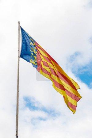 Flag of Valencia against sky