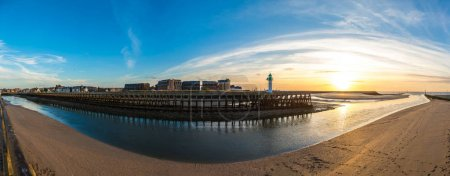 Panorama of Wooden Pier and Lighthouse