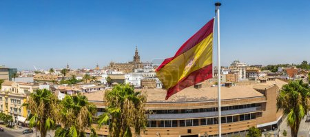 Spain flag and panoramic aerial view of Sevilla