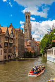 Canal in Bruges and famous Belfry tower