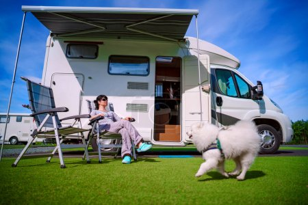 Photo for Woman resting on a chair on the nature. Caravan car Vacation. Family vacation travel, holiday trip in motorhome - Royalty Free Image