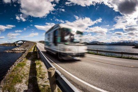 "Photo for Caravan car RV travels on the highway. Caravan Car in motion blur. Norway. Atlantic Ocean Road or the Atlantic Road (Atlanterhavsveien) been awarded the title as ""Norwegian Construction of the Century"". - Royalty Free Image"