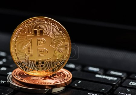Photo bitcoins coins on notebook keyboard