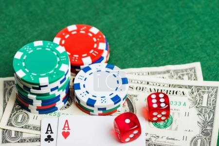 Casino green table with chips, money and dices