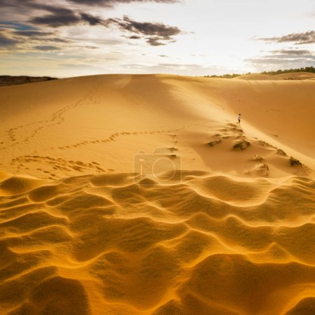 Photo for Sand dunes and a running man - Royalty Free Image