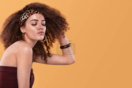 Photo for Beauty portrait of young african american girl with afro hairstyle. Girl posing on color background, looking at camera. Studio shot. - Royalty Free Image