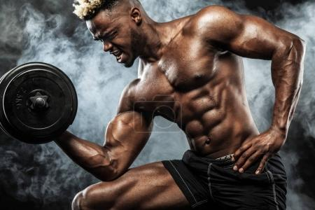 Photo for Athletic shirtless young sports man - fitness model with barbell in gym. - Royalty Free Image