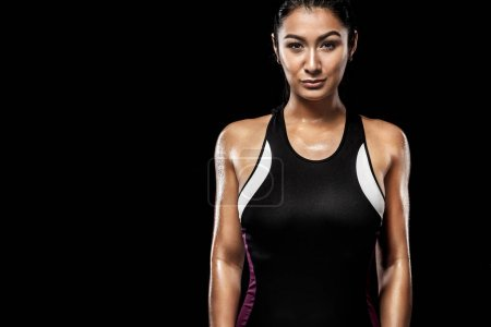 A strong athletic, woman on black background wearing in the sportswear, fitness and sport motivation.
