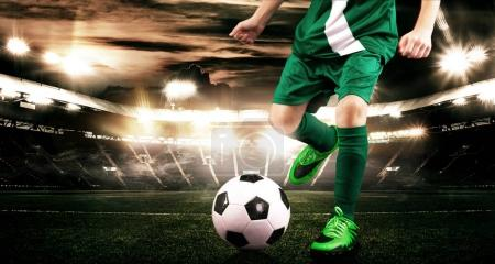 Photo for Kids in soccer sportswear on stadium with ball. - Royalty Free Image