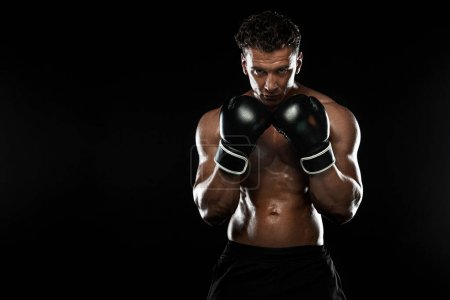 Photo for Street fighter fighting in boxing gloves. Isolated on black background with copy Space. Action shot. Sport concept. - Royalty Free Image