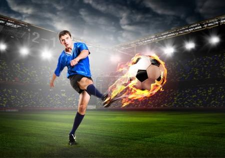 Photo for Soccer or football player is kicking ball on stadium - Royalty Free Image