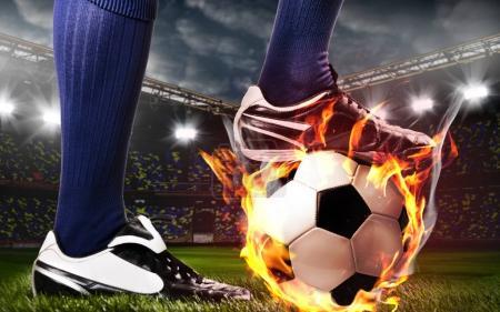 Photo pour Jambes de joueur de soccer ou de football au stade - image libre de droit