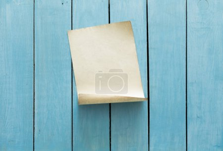 blank paper on wooden wall