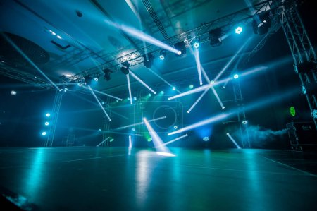 Photo for Dancing at the concert,Illumination, light on the stage at the disco - Royalty Free Image