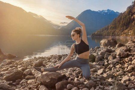 yoga fitness girl on nature landscape