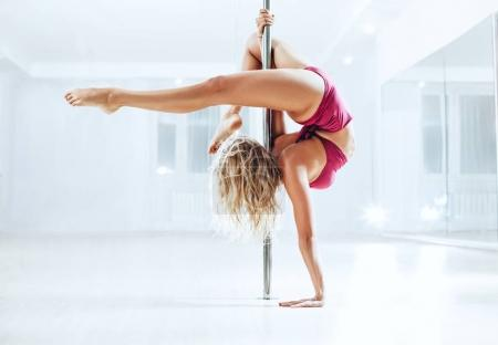 Slim pole dance woman
