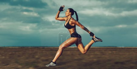Young sports woman running