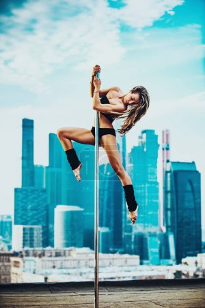 Young pole dancing woman