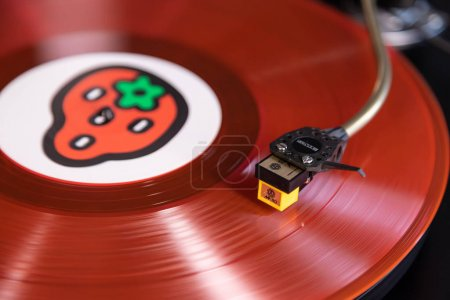 Photo for Vintage Stereo Turntable Plays Red Vinyl Record Album, Tonearm with Headshell Closeup - Royalty Free Image