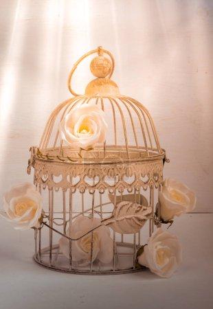 Decorative roses in vintage metal cage