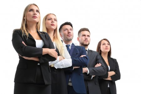 Team of successful and confident people posing on a white backgr
