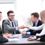 Handshake between business people in a modern offi...