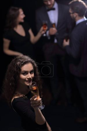 stylish young woman with glass of champagne