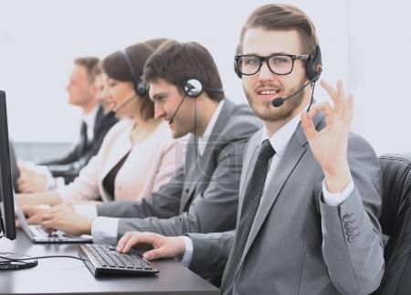 """customer service representative with headset showing sign """"OK"""""""