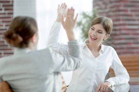 members of the business team giving each other a high five.