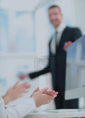 Attractive man making a business presentation to a group