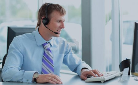 Businessman using headphones and smiling at office
