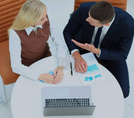 Business meeting at the table with laptop