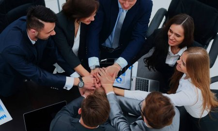 Business people showing unity with their hands together