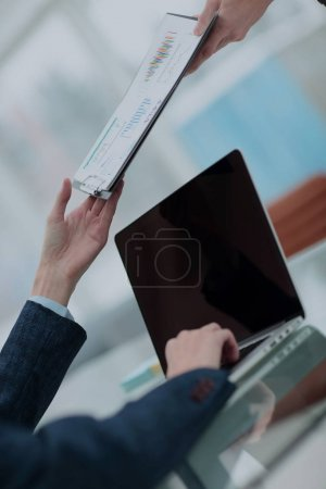 Businessman his colleague giving contract to read and sign
