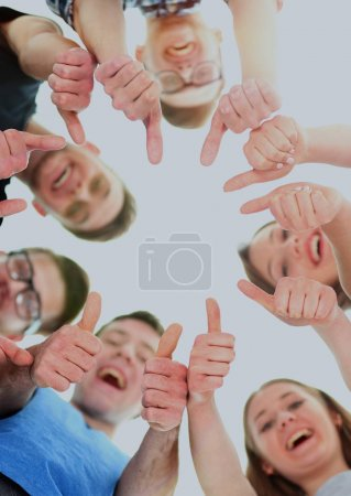friendship, youth and people concept - group of smiling teenagers with hands on top  each other