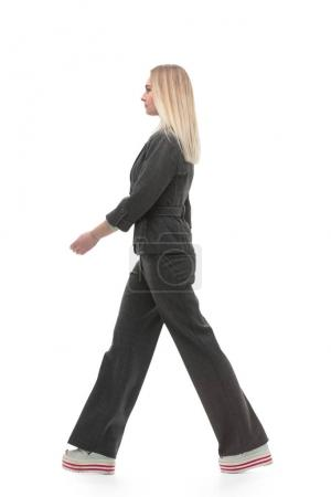 full growth.motivated business woman walking forward.