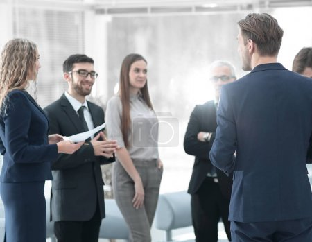 image is blurred.the Manager makes a report to the business team.