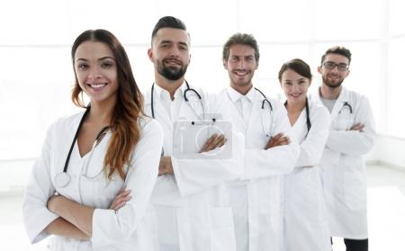 Portrait of medical team standing with arms crossed in hospital