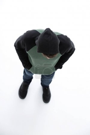 view from above. Hipster in a jacket with a hood looking down