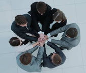 concept of the team .standing in a circle of friendly business t