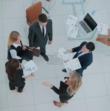 Photo for Business team studying and discussing documents. High view - Royalty Free Image
