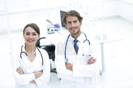 Portrait of two successful professional doctors workers in coats