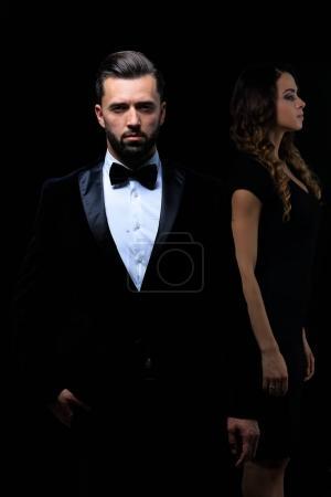gentleman with his girl posing in the studio