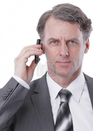 closeup.serious businessman talking on mobile phone.
