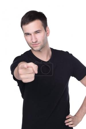 Young man points a finger straight isolated on white