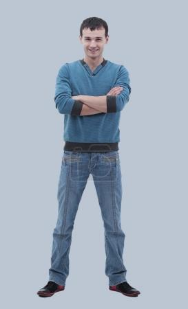 Young happy casual man portrait, isolated on gray background
