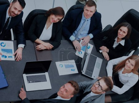 meeting around a table in an office